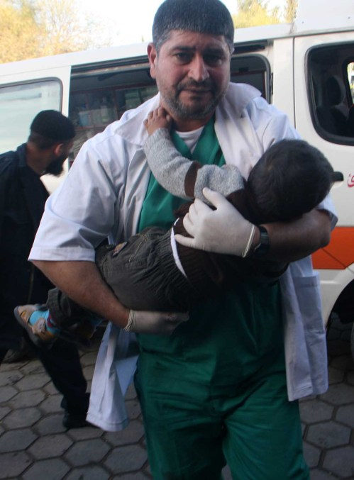A medic, holding a child carrying into the hospital...