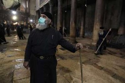 Palestinian Muslims helping to clean the Church