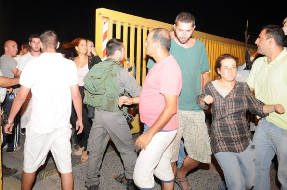 Palestinians and activists scuffle with with settlers of Almon