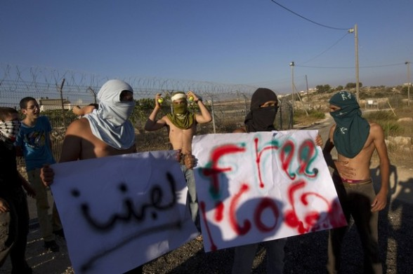 Jewish settlers dressed as Palestinian protesters participate in a drill in the West Bank settlement of Kiryat Arba.
