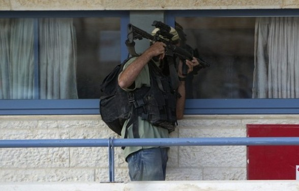 A Jewish settler participates in a drill in the West Bank settlement of Kiryat Arba.