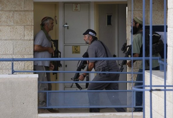 Jewish settlers participate in a drill in the West Bank settlement of Kiryat Arba.