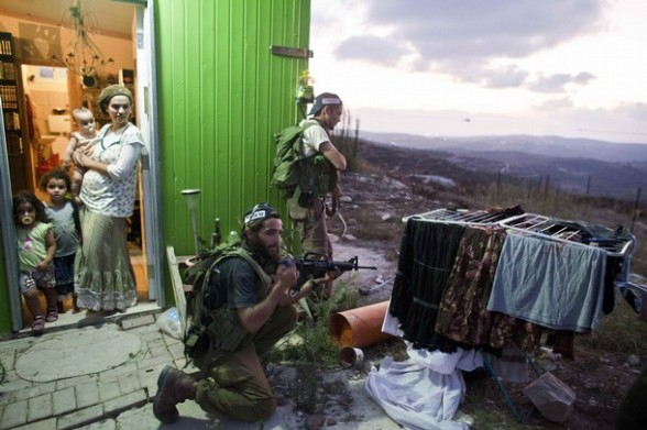 Jewish settlers take part in a general drill to protect their unauthorized outpost of Havat Gilad, south of Nablus