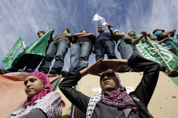 Palestinians wait at the Beituniya checkpoint near the West Bank city of Ramallah for the release of prisoners from Israeli jails