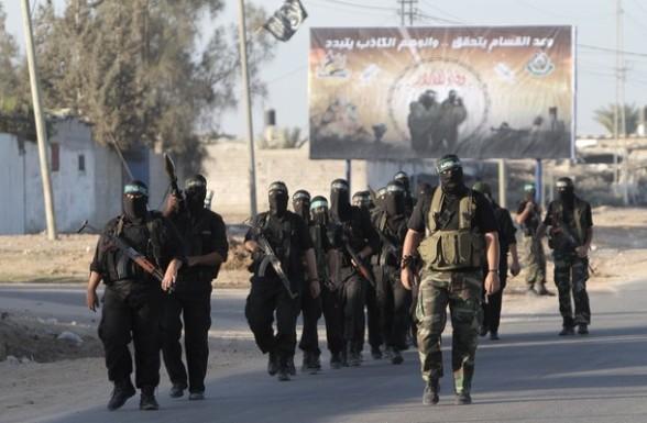 Armed Palestinian Hamas militants keep p