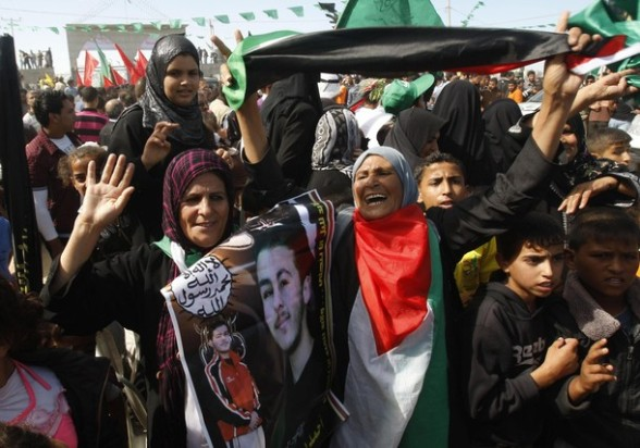 Relatives of Palestinian prisoners celebrate as they prepare to receive them at Rafah Crossing in the southern Gaza Strip