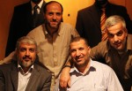 Hamas leader Meshaal poses for photograph with Al-Jabari, top commander of Al-Qassam brigades, and Palestinian prisoners (back) freed in a prisoner swap deal between Hamas and Israel in Cairo