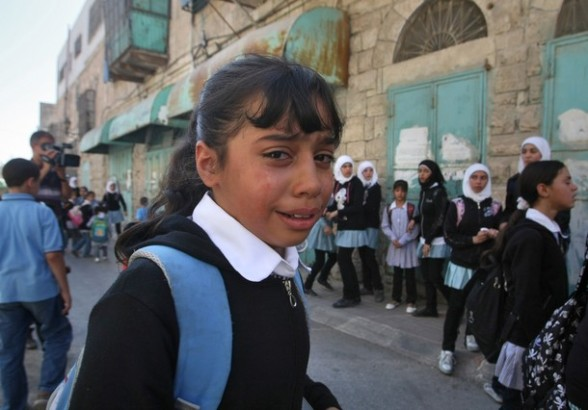 A Palestinian schoolgirl cries after Isr