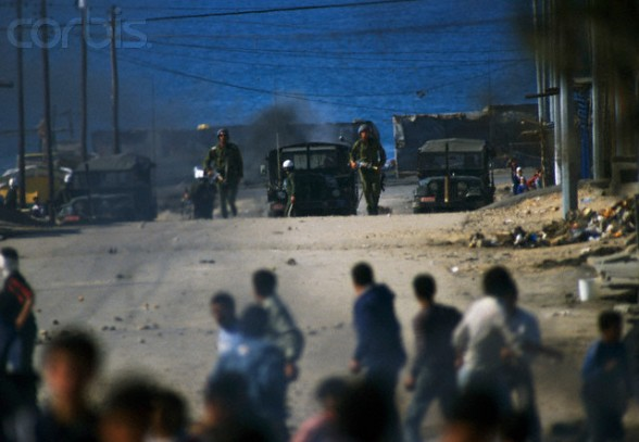 10 Feb 1988, Gaza, Gaza Strip --- Rebel Israeli and Palestinian fighters protest in the occupied territory of Gaza during the first Intifada. The Israeli administrative custody camp was closed and declared a military zone after violence broke out. --- Image by Patrick Robert/Sygma/CORBIS