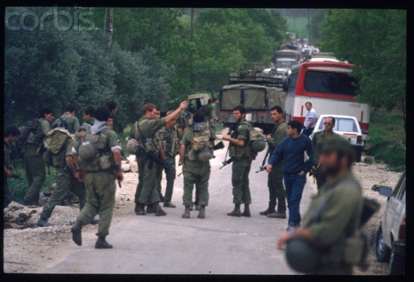 06 Apr 1988, West Bank --- Fighting between Jewish Settlers and Palestinians. Soldiers at the village's entrance. | Location: Beta, West Bank.  --- Image by  Bernard Bisson/Sygma/Corbis