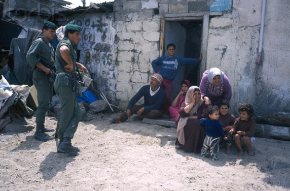 April 1988, Israel --- 6 months of disturbances in the occupied territories. Gaza: the Great Beach. Palestinian camp with the Israeli army. --- Image by Bernard Bisson/Sygma/Corbis