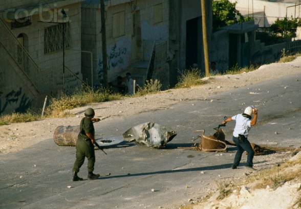 22 May 1990, Shu'fat, East Jerusalem, West Bank --- Israeli soldiers respond to rioting Palestinians in Shufat, Jerusalem. The riot is in response to a shooting by a discharged Israeli soldier that occurred two days before in Rishon le-Ziyyon, which killed eight Palestinian laborers and wounded nine others. --- Image by Patrick Robert/Sygma/Corbis