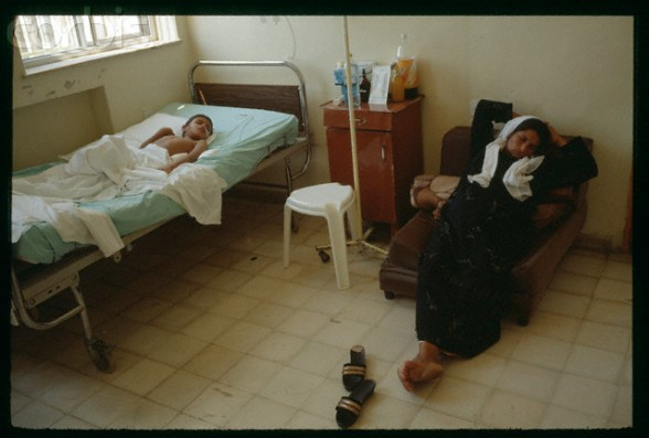 "06 Sep 1990, Jerusalem, Israel --- Woman sleeping by young wounded Palestinian at Makassed hospital in Jerusalem. The ""Intifada hospital"" depends on financing from Kuwait and Saudi Arabia. --- Image by Antoine Gyori/Sygma/Corbis"