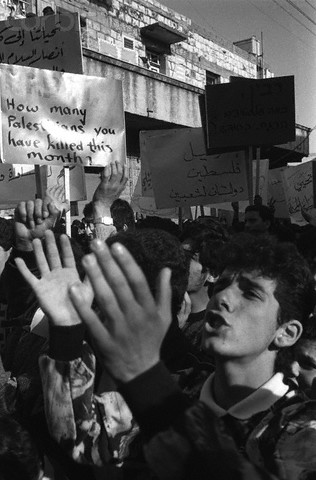 1988-1989, Nazareth, Israel --- Palestinian protest march in the town of Nazareth. --- Image by © Keith Dannemiller/Corbis