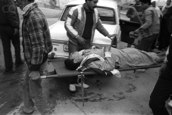 1988-1989, Gaza, Gaza Strip --- A Palestinian boy, wounded in a street clash with Israeli soldiers, is carried on a stretcher into the emergency room of Ahli Arab Hospital in Gaza City. --- Image by © Keith Dannemiller/Corbis