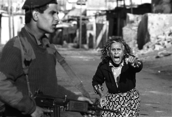 1988-1989, Gaza, Gaza Strip --- A Palestinian woman yells at Israeli soldiers who have just arrested one of her sons after a street confrontation in Beach Camp for refugees in the Gaza Strip. --- Image by © Keith Dannemiller/Corbis