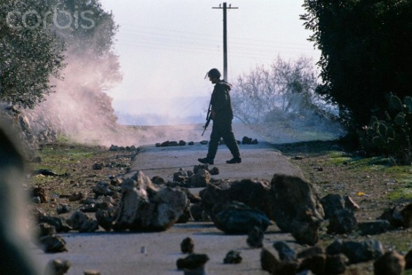 12 Jan 1989, West Bank --- Israeli settlers clash with the army in the West Bank during the Intifada. --- Image by  Ricki Rosen/CORBIS SABA