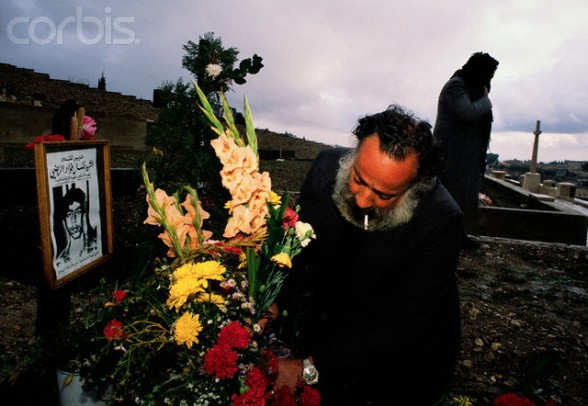 25 Dec 1988, Jerusalem, Israel --- A Palestinian man visits the grave of 15-year-old Nidel, who was killed in the Intifada, a violent uprising by Palestinians against the Israeli occupation. --- Image by Ricki Rosen/CORBIS SABA