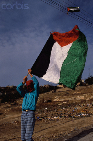 09 Dec 1989, Jerusalem, Israel --- A masked Palestinian demonstrates in the Jewish settlement of Jebel Mukaber on the second anniversary of the Intifada, a violent Palestinian uprising against the Israeli occupation. | Location: Jebel Mukaber, Jerusalem, Israel.  --- Image by Ricki Rosen/CORBIS SABA