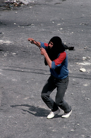 ca.1988 --- One of the many rocks hurled in the Intifada, by young masked Palestinians, in the West Bank town of Bet Sachour. | Location: Bet Sachour, Israeli Occupied Territories.  --- Image by David H. Wells/CORBIS