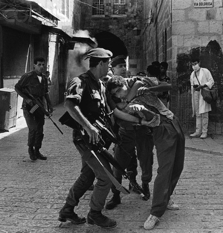 ca. 1991, Jerusalem, Israel --- Israeli soldiers tussle with a young Palestinian suspected of throwing stones on the Via Dolorosa. --- Image by  David H. Wells/CORBIS