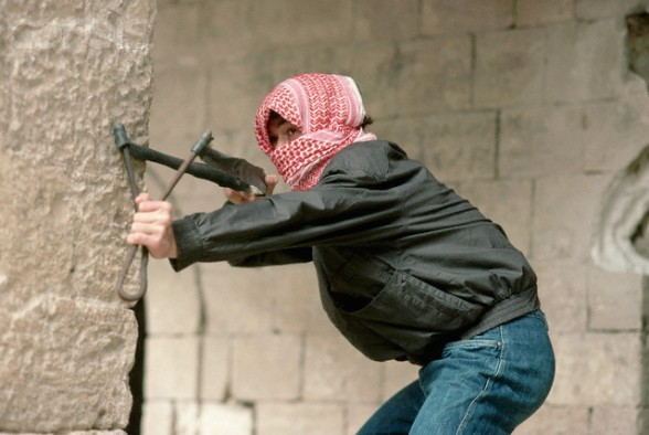 ca. April 1988, West Bank --- A Palestinian shabiba (youth) takes aim with a slingshot during the Intifada. --- Image by  Jeffrey L. Rotman/CORBIS