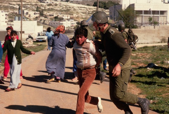 16 Mar 1988, West Bank --- Israeli Soldier Arresting Palestinian Boy --- Image by  Peter Turnley/CORBIS