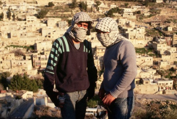 1988, West Bank --- Masked Palestinian Guerrillas --- Image by  Peter Turnley/CORBIS