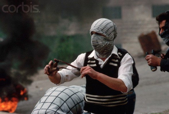 March 18-19, 1988, West Bank --- Masked Palestinians fight against the occupying Israeli forces in the West Bank. --- Image by  Peter Turnley/CORBIS