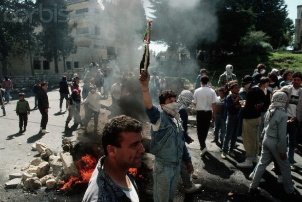 March 18-19, 1988, West Bank --- A group of young Palestinians block a road into a town on the West Bank. --- Image by Peter Turnley/CORBIS