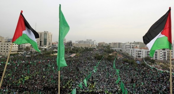 Palestinian and Hamas flags flutter as t