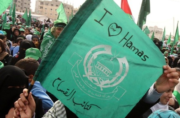 A Palestinian supporter of Hamas holds t