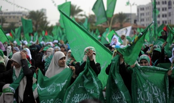 Palestinian supporters of Hamas wave the