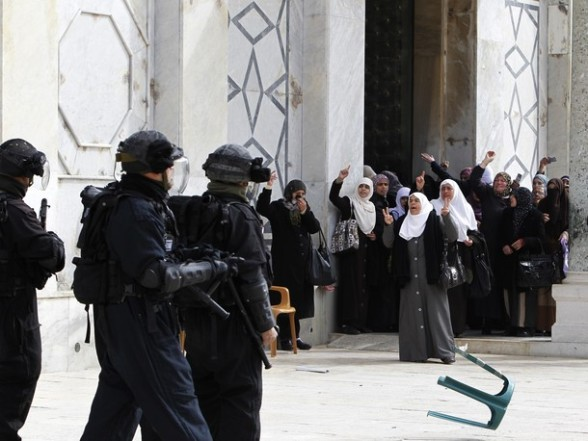 Palestinian women gesture as they shout at Israeli policemen during clashes on the compound known to Muslims as the Noble Sanctuary and to Jews as the Temple Mount in Jerusalem's Old City February 24, 2012. Israeli policemen stormed the compound on Friday following prayers, using stun grenades to disperse stone-throwing Palestinian protesters, some of whom then retreated into al-Aqsa mosque. Israeli police spokesperson said 11 policemen were lightly injured from stones and 4 protesters were arrested. REUTERS/Ammar Awad