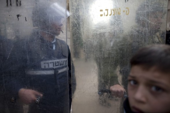 Israeli border policemen stand behind shields in the old city of Jerusalem on February 24, 2012 as clashes broke out between Israeli police and