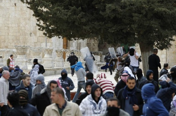Palestinian protesters run away from Israeli policemen during clashes on the compound known to Muslims as the Noble Sanctuary and to Jews as the Temple Mount in Jerusalem's Old City February 24, 2012. Israeli policemen stormed the compound on Friday following prayers, using stun grenades to dispersed stone-throwing Palestinian protesters, some of whom then retreated into al-Aqsa mosque. Israeli police spokesperson said 11 policemen were lightly injured from stones and 4 protesters were arrested. REUTERS/Ammar Awad