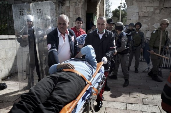 A wounded Palestinian protester is evacuated by paramedics in the old city of Jerusalem on February 24, 2012 after clashes broke out between Israeli police and