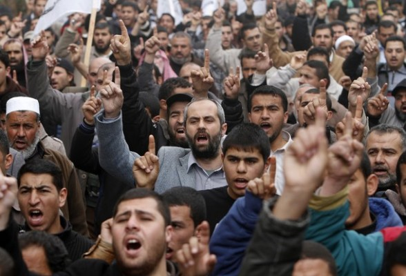 Palestinian protesters shout slogans as they gather in Khan Yunis in the southern Gaza Strip on February 24, 2012 during a demonstration to show solidarity for Jerusalem's Al-Aqsa mosque compound. Clashes briefly broke out between Israeli police and