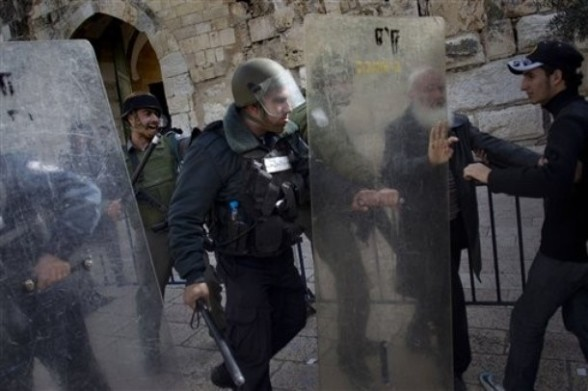 Israeli security forces scuffle with Palestinians in one of the entrances of the Al Aqsa Mosque compound, known by the Jews as the Temple Mount, in Jerusalem, Friday, Feb. 24, 2012. Israeli police clashed with hundreds of Palestinians throwing rocks after Muslim prayers at Jerusalem's most sensitive holy site. (AP photo/Bernat Armangue)