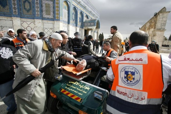 Paramedics rush an elderly Palestinian man out of the site of clashes at the flashpoint Al-Aqsa mosque compound in Jerusalem's old city on February 24, 2012. Clashes briefly broke out between Israeli police and