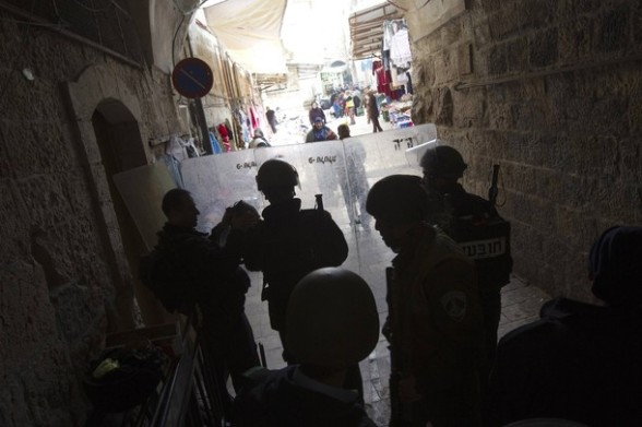 Israeli policemen stand guard behind their shields near an entrance to the compound known to Muslims as the Noble Sanctuary and to Jews as the Temple Mount in Jerusalem's Old City February 24, 2012. Israeli policemen stormed the compound on Friday following prayers, using stun grenades to disperse stone-throwing Palestinian protesters, some of whom then retreated into al-Aqsa mosque. Israeli police spokesperson said 11 policemen were lightly injured from stones and 4 protesters were arrested. REUTERS/Ronen Zvulun