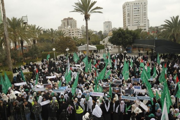 Palestinians gather as they protest in Gaza City on February 26, 2012, two days following violence in the flashpoint Al-Aqsa mosque compound in Jerusalem's Old City, between Israeli forces and Palestinians. The unrest is believed to have been fuelled by web postings by Israeli rightists urging Jews to visit the mosque compound and assert Israeli sovereignty over the site, one of the most sensitive in the Middle East. Know to Muslims as Al-Haram Al-Sharif it considered the third holiest site in Islam, while it is known to Jews as the Temple Mount and is revered as Judaism's most sacred place. AFP PHOTO/MOHAMMED ABED