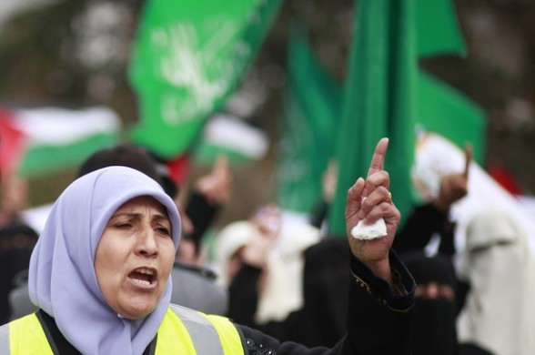 A Palestinian woman takes part in a rally organised by the Hamas movement in Gaza City, to show solidarity with the al-Aqsa Mosque in Jerusalem February 26, 2012. REUTERS/Suhaib Salem