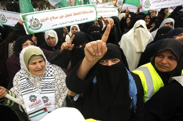Palestinian women gather as they protest in Gaza City on February 26, 2012, two days following violence in the flashpoint Al-Aqsa mosque compound in Jerusalem's Old City, between Israeli forces and Palestinians. The unrest is believed to have been fuelled by web postings by Israeli rightists urging Jews to visit the mosque compound and assert Israeli sovereignty over the site, one of the most sensitive in the Middle East. Know to Muslims as Al-Haram Al-Sharif it considered the third holiest site in Islam, while it is known to Jews as the Temple Mount and is revered as Judaism's most sacred place. AFP PHOTO/MOHAMMED ABED