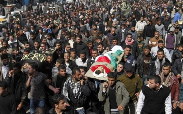 Palestinian mourners carry the bodies of seven Islamic Jihad militants (not all seen in picture), who were killed in Israeli air strikes, during their funeral in Gaza City on March 10, 2012. Twelve Palestinian fighters were killed and at least 20 people wounded in a series of Israeli air strikes on the Gaza Strip, Palestinian medics said. AFP PHOTO/MOHAMMED ABED