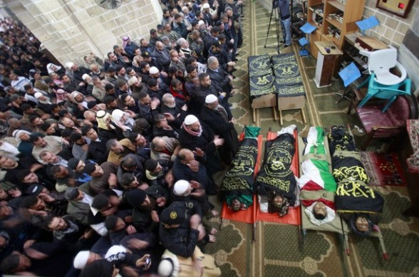 Palestinians pray near the bodies of Islamic Jihad militants during their funeral in Gaza March 10, 2012. Israel killed two more Gaza militants on Saturday, raising the death toll in two days of violence to 12. REUTERS/Suhaib Salem