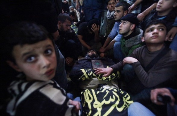 Mourners gather around the body of an Islamic Jihad militant during his funeral in Gaza March 10, 2012. Israel killed two more Gaza militants on Saturday, raising the death toll in two days of violence to 12  REUTERS/Suhaib Salem