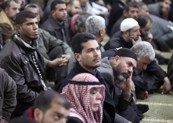 Palestinians attend the funeral of Islamic Jihad militants in Gaza March 10, 2012. Israel killed two more Gaza militants on Saturday, raising the death toll in two days of violence to 12. REUTERS/Suhaib Salem (GAZA - Tags: POLITICS CIVIL UNREST)