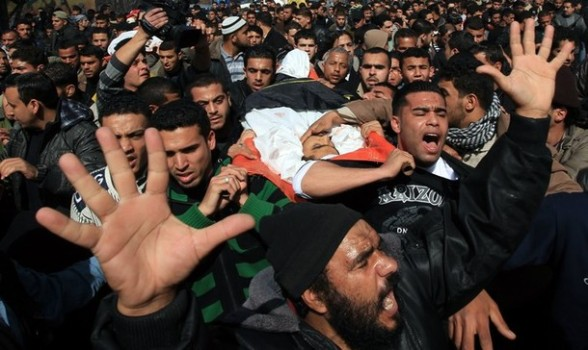 Palestinian mourners carry the bodies of Islamic Jihad militants, who were killed in Israeli air strikes, during a mass funeral in Al-Omari mosque in Gaza City on March 10, 2012. Israeli air strikes on Gaza killed 14 Palestinians, including a militant group chief, medics said on March 10, in the deadliest 24 hours in the border area in more than three years. AFP PHOTO/MAHMUD HAMS
