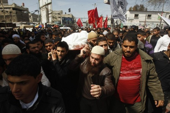 Palestinians carry the body of the Popular Resistance Committees leader Zuheir al-Qessi during his funeral in Rafah in the southern Gaza Strip March 10, 2012. Israel killed four Gaza militants on Saturday as violence sparked by the death of a militant leader a day earlier escalated with gunmen firing more than 90 rockets at Israel, injuring four people, Israeli and Palestinian officials said. REUTERS/Ibraheem Abu Mustafa